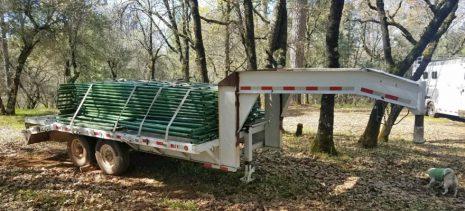 Pole fences on a trailer